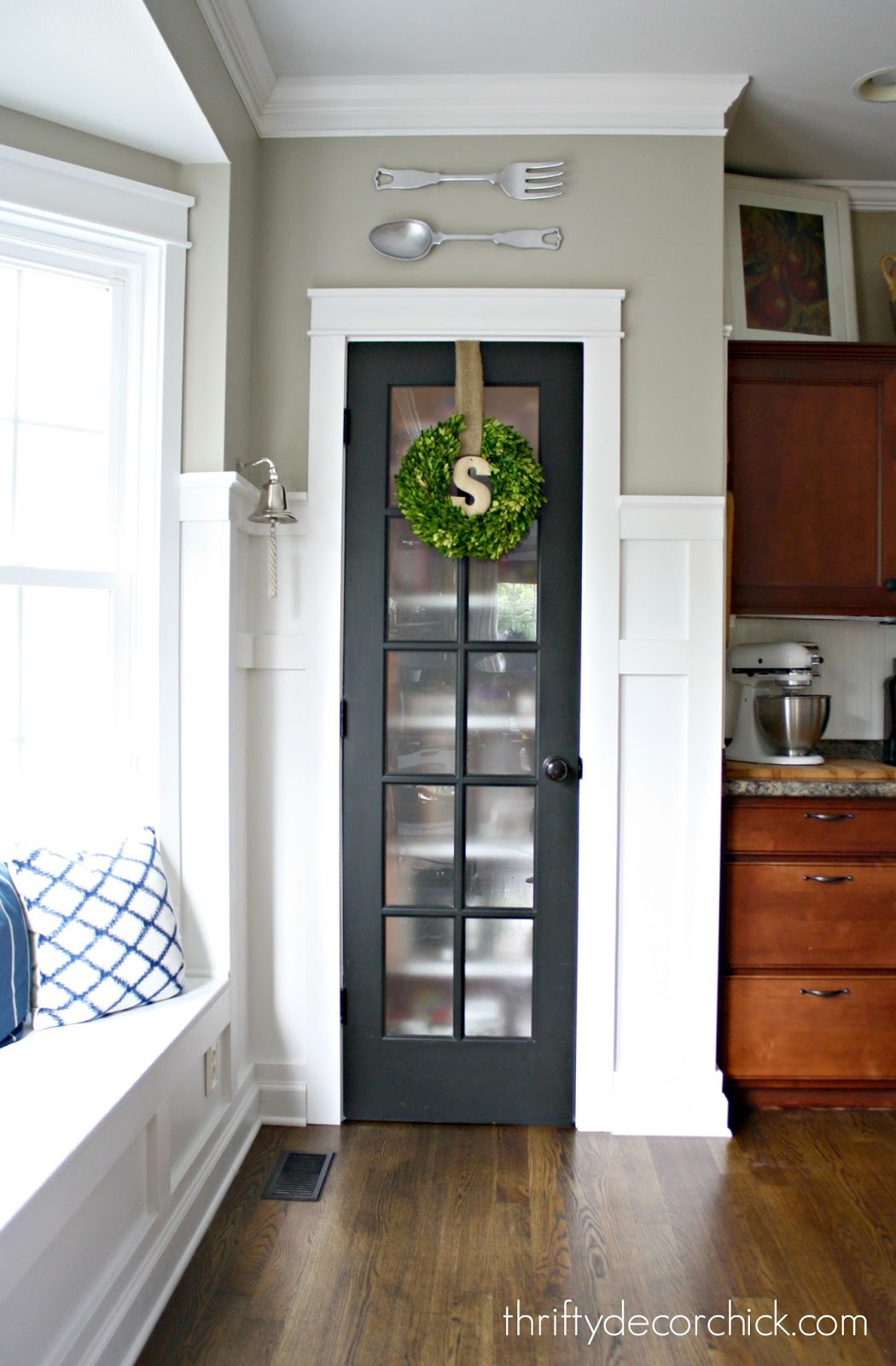 Boxwood werath hung on pantry door