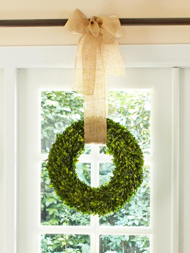 boxwood wreath hung on curtain rod