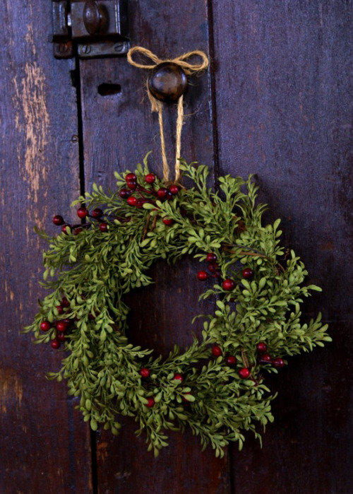 boxwood wreath with red berries