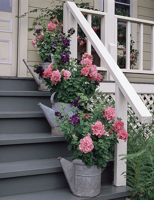 front porch flowers and watering cans