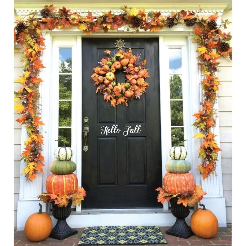Fall front porch decorated with fall pumpkins