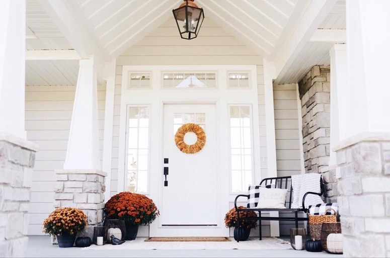 Fall front porch decorating with pumpkins